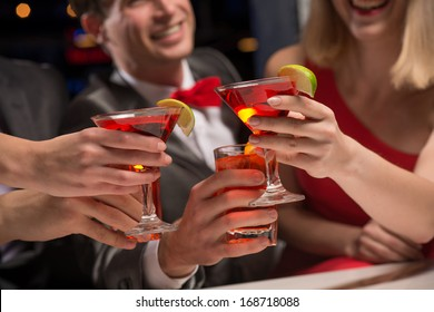 close-up of hands with glasses, a toast, party with friends