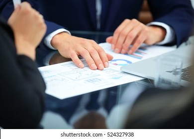 close-up of hands holding economist financial schedules for the development of the company