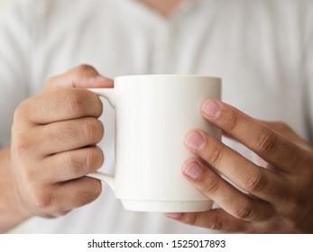 Close-up hands holding a mug mock-up