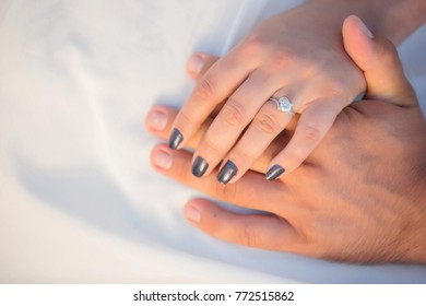 closeup hands of married young people