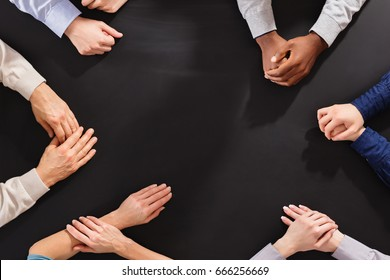 Close-up Of Hands On Empty Black Board