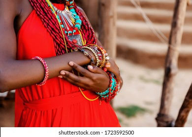 close-up of hands with ornaments from fashionable ethnic motifs. dark-skinned woman