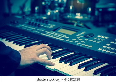 Closeup hands playing the keyboard or piano on brand music instrument background, music concept