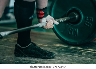 closeup of hands of powerlifter. deadlift barbell to competition