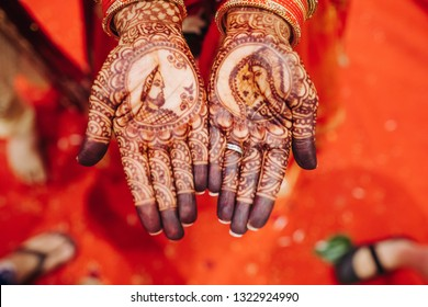 Closeup of hands of pretty Hindu bride with henna tattoo