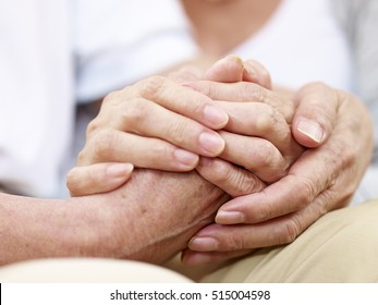close-up of hands of a senior couple held together, concept for love, help, comforting and consoling