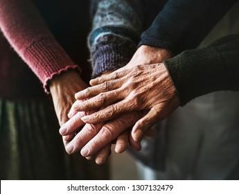 Closeup of hands of senior people