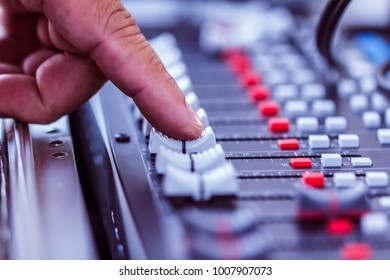 Close-up hands Sound mixer useful for various music