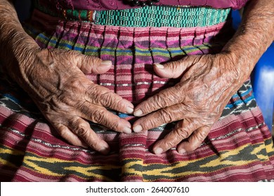 closeup of the hands of a very old mayan woman