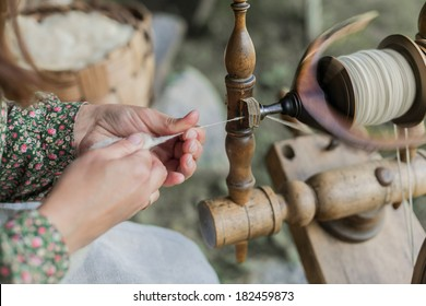Close-up of hands of a woman traditional wool spinning.