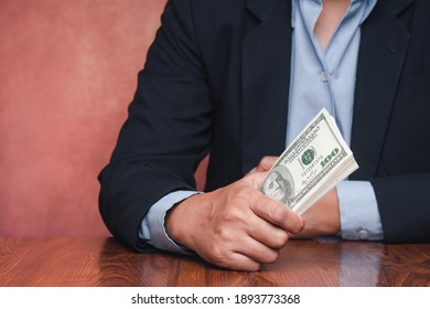 Close-up of hands young man holding US dollars with copy space for text. Concept of business and finance.