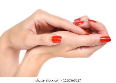 Closeup of hands of a young woman with red manicure on nails