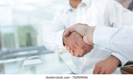 close-up handshake of business colleagues.