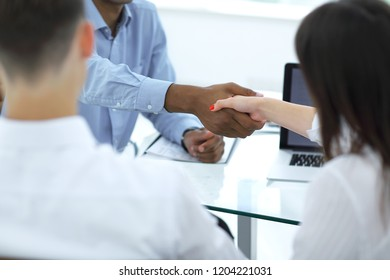 closeup.the handshake of employees in the workplace