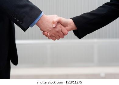 closeup handshake isolated on business background