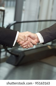 Close-up of a handshake with selective focus