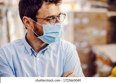 Closeup of handsome businessman wearing protective sterile mask.