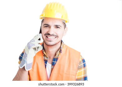 Closeup of handsome cheerful engineer talking on cell phone isolated on white background