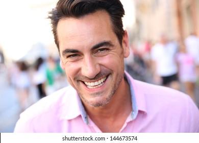 Closeup of handsome guy wearing pink shirt