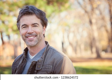Closeup Of A Handsome mature Man In a Forest
