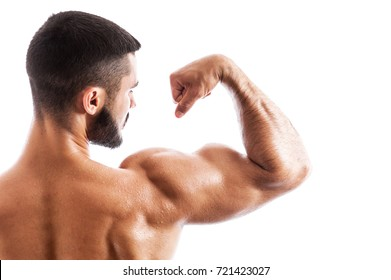 81dced89c Closeup of handsome muscular fitness model showing biceps muscles. Young man  with tattooed torso posing