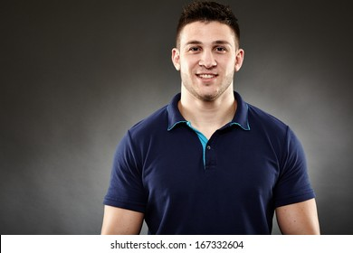 Closeup of handsome young man wearing a navy blue polo t-shirt