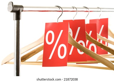 Close-up of hangers with red labels showing percentage in shop