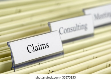 """Close-up hanging files """"Claims"""""""