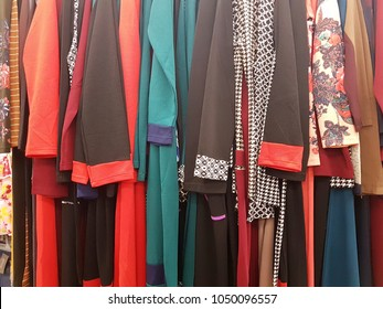 Closeup of hanging jubah or woman's long dresses in different color
