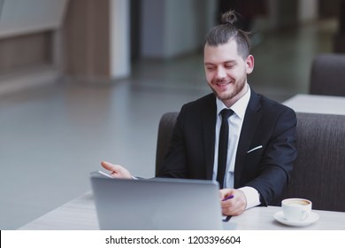closeup. happy businessman sitting at his Desk