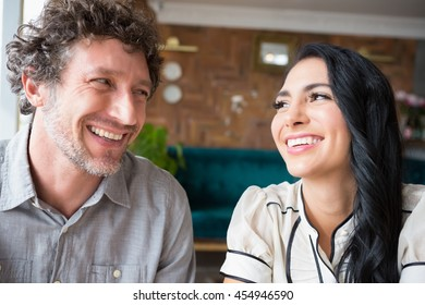 Close-up of happy couple looking at each other in cafeteria