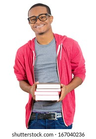 Closeup of a happy excited young handsome man holding books, ready to receive knowledge after enrollment in college, isolated on white background. Positive human emotions, facial expressions, feelings