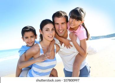 Closeup of happy family at the beach