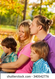 Close-up of happy family sitting together in hug