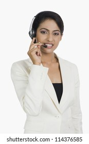 Close-up of a happy female customer service representative