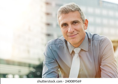 Closeup Of Happy Mature Businessman Smiling Outdoor