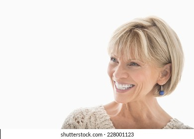 Close-up of happy mature woman looking away over white background
