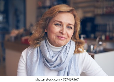 Closeup of happy mature woman looking at camera