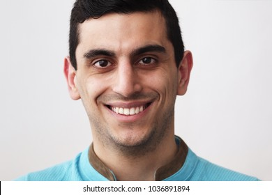 Close-up of a happy middle eastern man smiling, white background