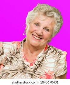 Close-up Of Happy Senior Woman On Coloured Background