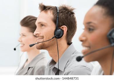 Closeup Of Happy Telephone Operators In A Row