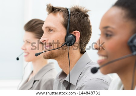 Closeup Of Happy Telephone Operators In A Row