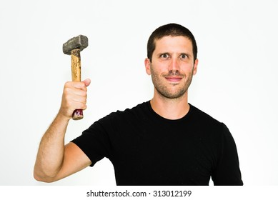 close-up of happy young caucasian man ready to repair something with an hammer - isolated on white background