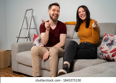 Closeup of happy young couple holding keys of their new home