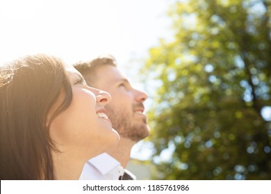 Close-up Of A Happy Young Couple Looking Up