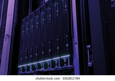 Close-up of hard drives disk storage of mainframe in modern data center. Cloud computing service business concept: