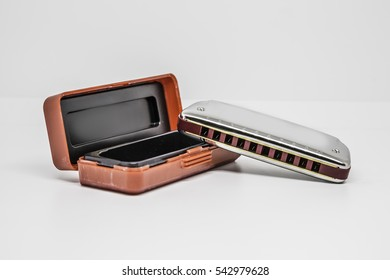 Closeup of harmonica mouthorgan with box cover