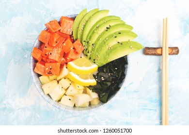 Close-up of Hawaiian appetizer or main dish poke bowl on colorful background. Colorful food concept. Flat-lay, top view. Copy space for your text.