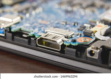Close-up of an HDMI port in a laptop computer motherboard