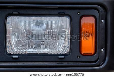 Closeup headlight Military car